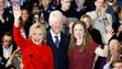 The Clintons acknowledge supporters during a caucus