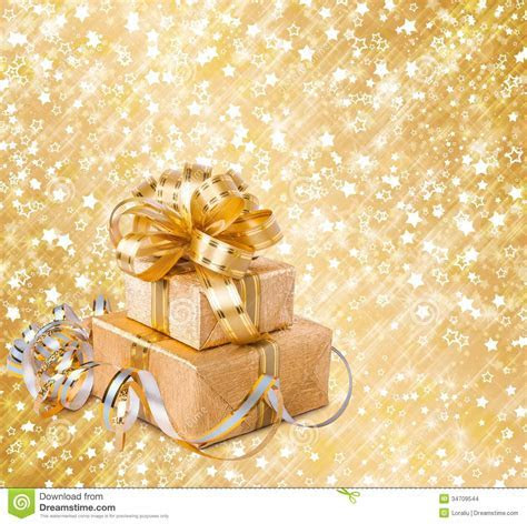 Gift Box In Gold Wrapping Paper Stock Photo   Image: 34709544