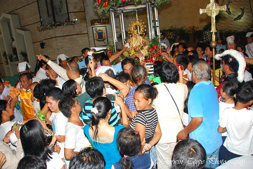 Our Lady of Peñafrancia and devotees at Virac church.