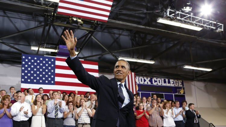 U.S. President Barack Obama waves after speaking about the economy in Illinois