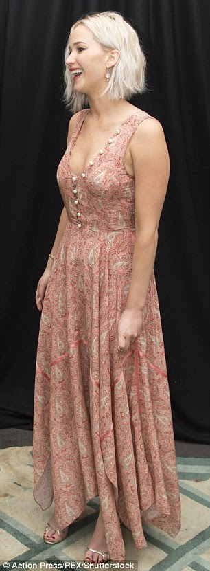 Pretty: The Oscar winner went for an ultra feminine look in a low-cut coral, paisley maxi dress and gold strappy sandals