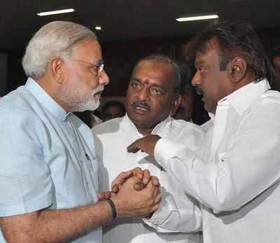 மோடி - பொன்னார் - விஜயகாந்த்