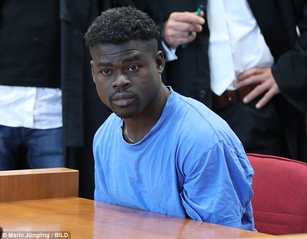 A failed asylum seeker - identified only as Eric X (pictured in court) - raped a woman camping in a nature reserve while threatening her with a machete. He was jailed for 11 and a half years