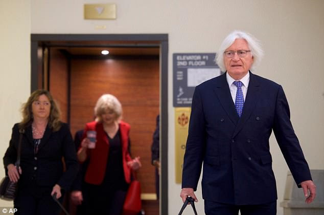 Defense attorney Tom Mesereau, who was caught snoozing in court on Wednesday, walks through the courthouse on Thursday