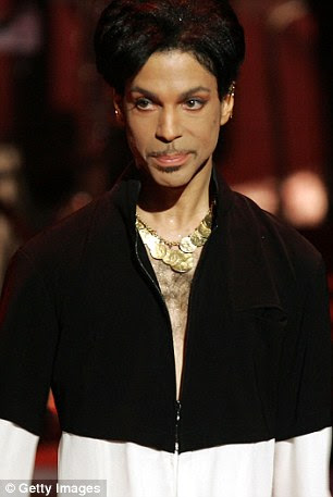 Prince (pictured on stage in 2005 in Los Angeles) showed up Bible in hand at a couple's doorstep in Eden Prairie, Minnesota, in 2003