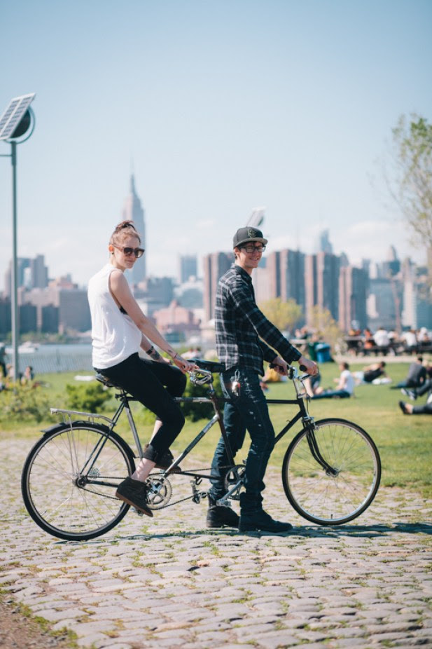 Keith and Katie ride a homemade tandem bike photographed at East RIver State Park, Kent Ave. and N. 8th St., Brooklyn en route to a picnic