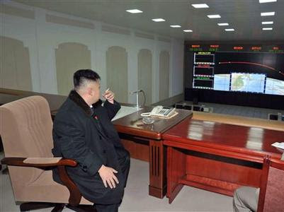 North Korean leader Kim Jong-Un smokes a cigarette at the General Satellite Control and Command Center after the launch of the Unha-3 (Milky Way 3) rocket carrying the second version of Kwangmyongsong-3 satellite at West Sea Satellite Launch Site in Cholsan county, North Pyongan province in this December 12, 2012 file photo, released by the North Korea's KCNA news agency in Pyongyang December 13, 2012. REUTERS-KCNA