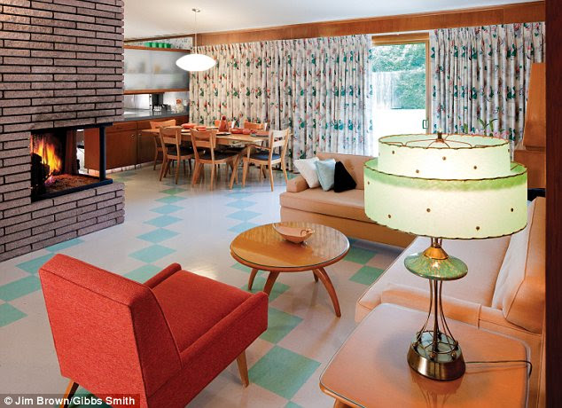 A salmon-coloured carpet, avocado green bed cover and blonde wood ...