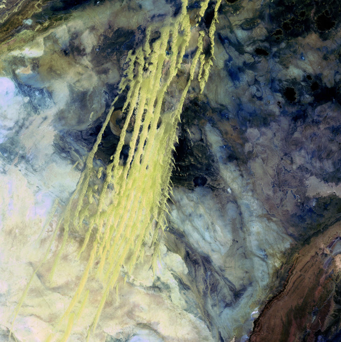 pale yellow paint streaks slash through a mosaic of mottled blue and smoke colors like azurite