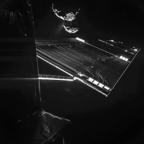 An image that the Philae lander took of Rosetta and one of its twin solar panels just as the spacecraft orbited 16 kilometers (10 miles) above Comet 67P/Churyumov–Gerasimenko...on October 7, 2014.