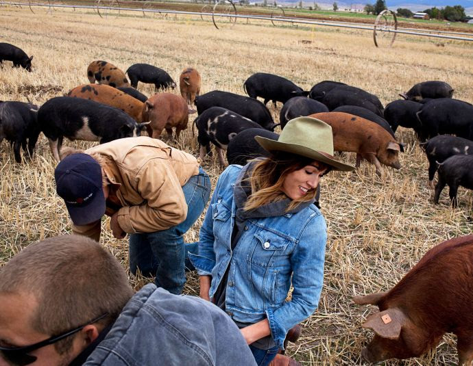 """Anya Fernald, with employees, at the Belcampo farm, in Gazelle, California. She wants to restore meat to its status as a luxury: delectable, expensive, and rare. """"Ex-vegetarians are our target market,"""" she says."""