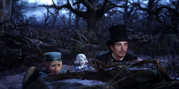 Oscar Diggs, China Girl (voiced by Joey King) and Finley (voiced by Zach Braff) head to the Dark Forest to confront the Wicked Witch in OZ: THE GREAT AND POWERFUL.