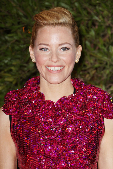 """Elizabeth Banks attends the """"Hunger Games"""" movie premiere, viewed by 1,500 fans at the Gaumont Marignan Cinemas on the prestigious Avenue des Champs Elysees in Paris."""