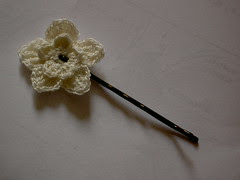 crocheted flower on a hairpin