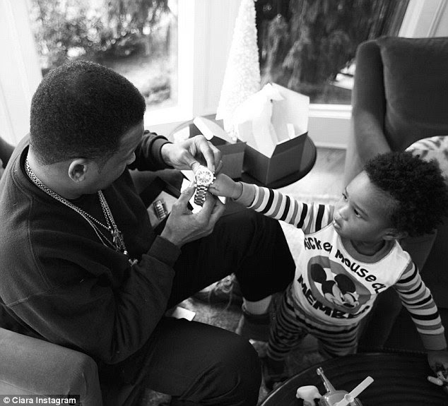 Santa's little helper: Future took it upon himself to hand out all the gifts, giving his granddad a watch