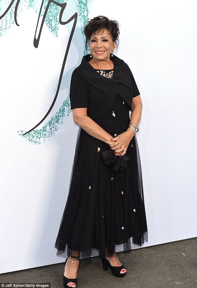 Opulent: Shirley Bassey looked resplendent in a black tulle gown adorned with decadent silver embellishments, which she teamed with black peep-toe heels