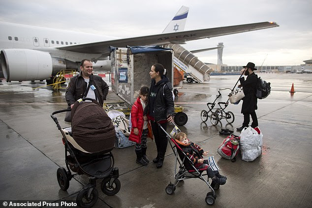 A Ukrainian family arrives at the Ben-Gurion International Airport nearTel Aviv as a part of the exodus of Jews heading to Israel after a series of anti-Semitic attacks left many Jewish people feeling shaken