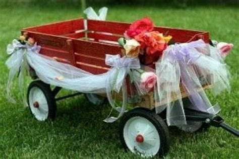 Red wagon decorated for wedding   Wedding decor