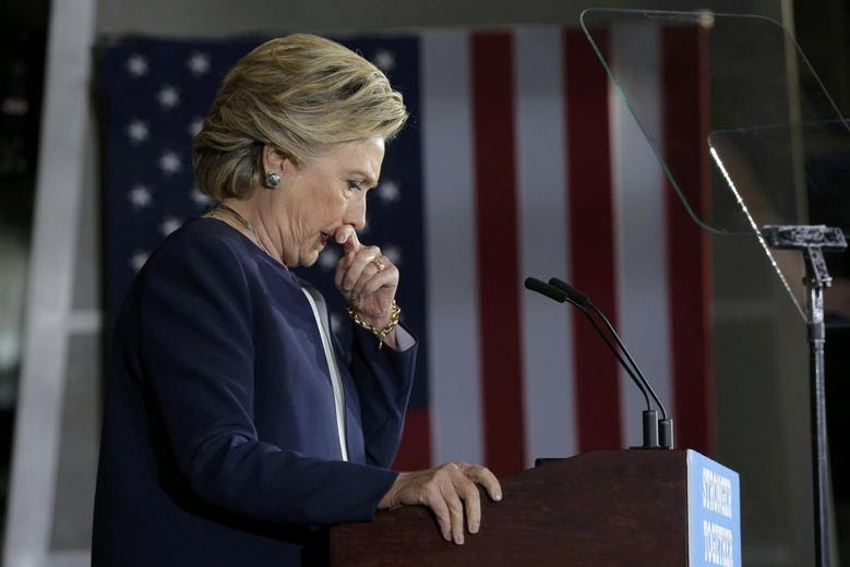 Democratic U.S. presidential nominee Hillary Clinton pauses while speaking at a campaign rally at Heinz Field in Pittsburgh, Pennsylvania, U.S., November 4, 2016.  REUTERS/Brian Snyder