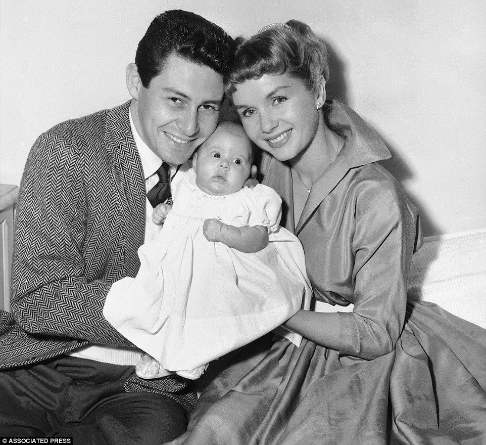 Fisher, pictured as a baby in 1956 alongside her parents, battled mental illness. She was diagnosed as bipolar at 24 and was treated with electroshock therapy and medication