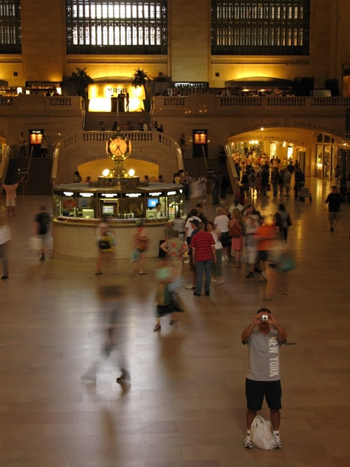 tourist Bob takes a photo in the main hall of Grand Central Station, Manhattan, NYC