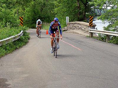Two riders inbound over the narrow bridge