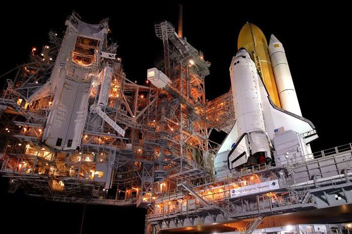 Space Shuttle Discovery arrives at its launch pad.