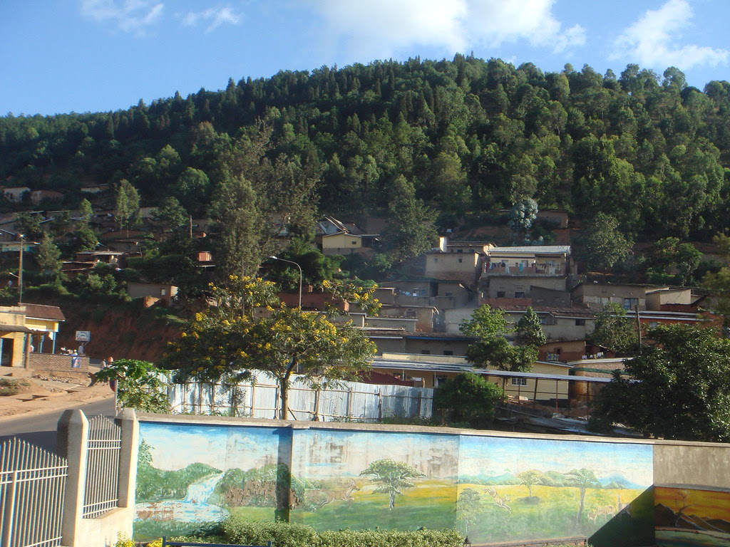 mountain and parking lot with mural