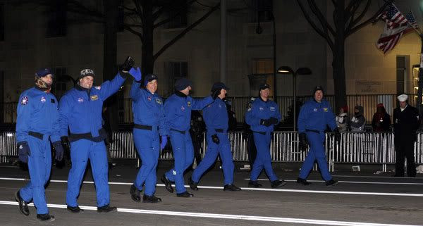 The 7-member crew of space shuttle flight STS-126 wave to the crowd during last night's Inaugural Parade in Washington, D.C.