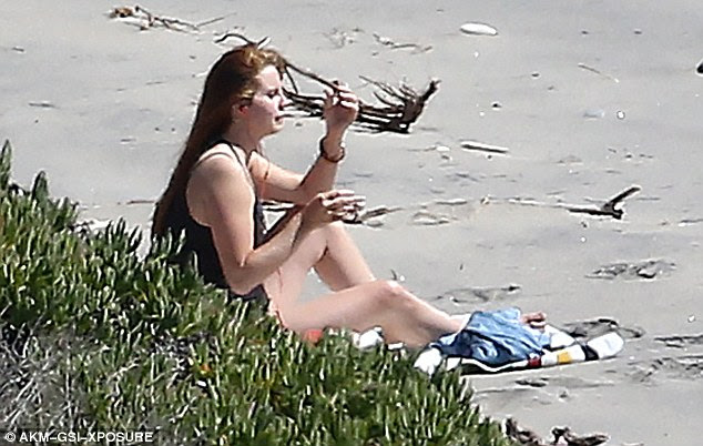 Stunner:Lana, real name Elizabeth Woolridge Grant, ditched her usual vintage vixen look for her low-key day on the shores where she looked naturally beautiful