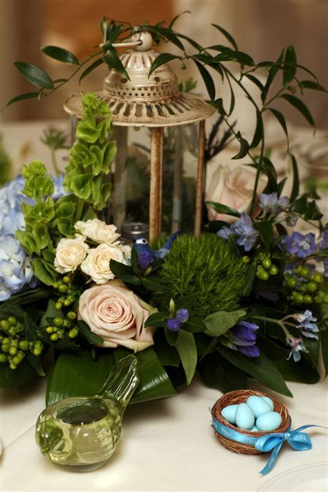 wedding centerpiece with a garden theme. lantern, an