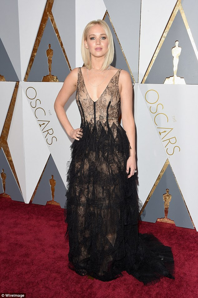 She's a lacy lady! Jennifer Lawrence shows off her toned figure in layered gown as she poses on Oscars red carpet on Sunday in Los Angeles