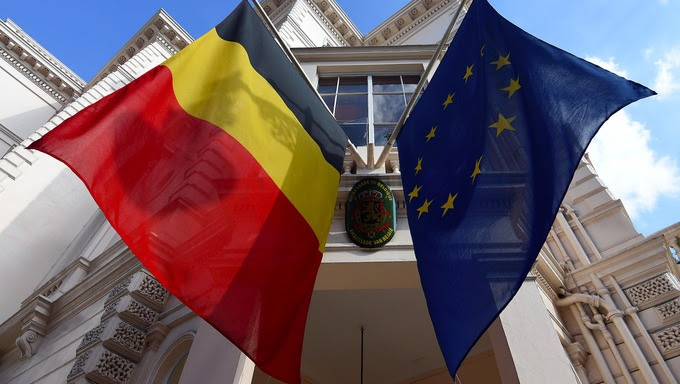 The Belgian and European Union flags fly at half mast outside the embassy of Belgium in London.