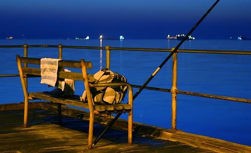 illuminated pier before sunrise