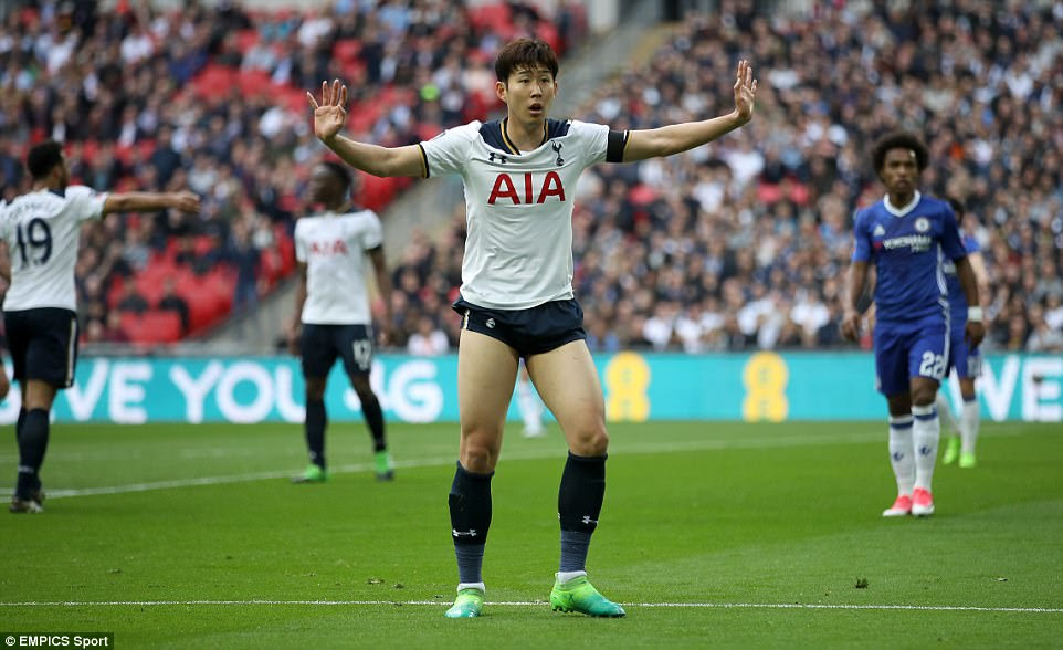 The South Korean star pleads his innocence to the assistant referee after Chelsea are awarded the penalty
