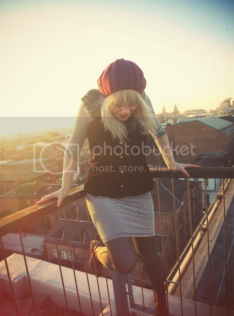 """The attic people wearing beret and boots"""" Title="""