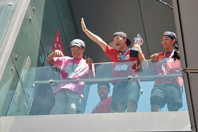 Korean boyband members waving