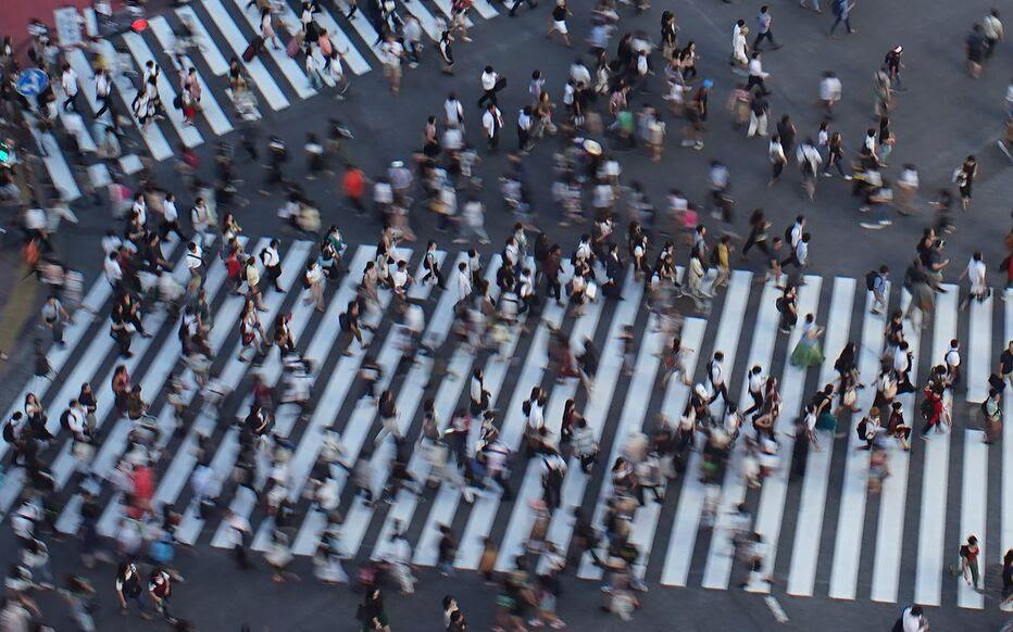 Des piétons à Tokyo en août 2018. Selon l'ONU, la population mondiale va augmenter plus fortement que prévu.