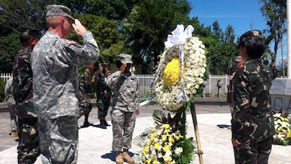 PAYING TRIBUTE. Philippine and US troops lay a wreath to honor allied soldiers who died in a concentration camp in Cabanatuan City during the Japanese Occupation, as part of activities under Balikatan 2012. Photo by David Santos