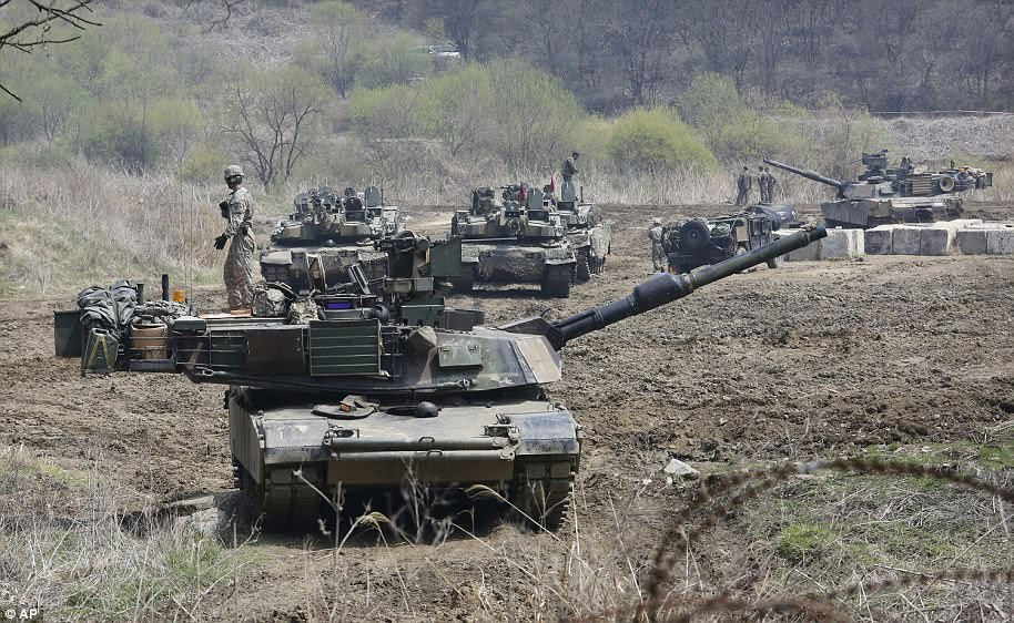 South Korean and US Army tanks take positions during a joint military exercise in Paju today