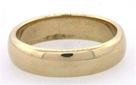 Tiffany & Co. heavy 18K gold comfort fit men's wedding