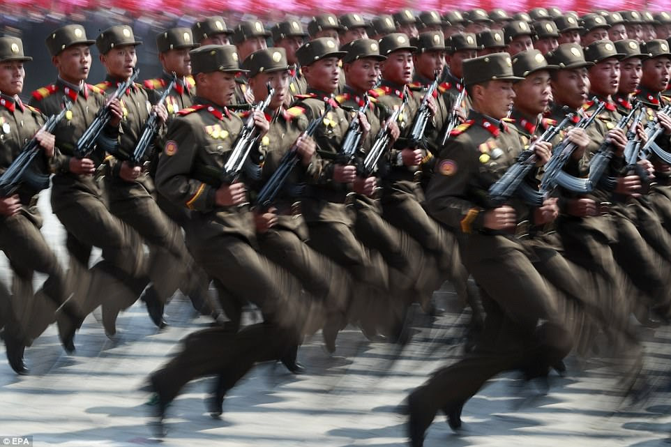 North Korea soldiers marched through Pyongyang, 24 hours after China warned the region could go to war 'at any moment'