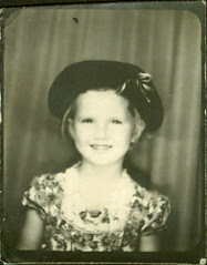 Photobooth Girl with hat in print dress
