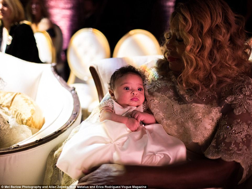 She's got you, babe: Two-month-old Alexis Olympia Ohanian Jr watched on in her grandmother's arms as her parents tied the knot in New Orleans