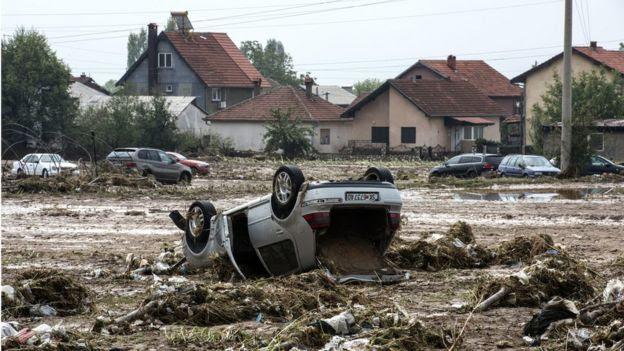 upside down car in a muddy field, 7 August 2016