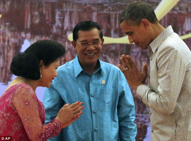 Coded slight? First Lady Rany greeted the President with a pressed-hands greeting typically used only with servants