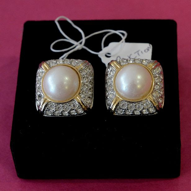 A pair of costume earing owned by actress Joan Collins which were worn when she filmed the American soap opera Dynesty.