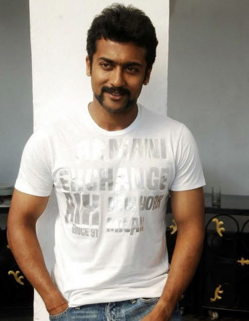 Surya posing for a photoshoot with his stylish new mustache