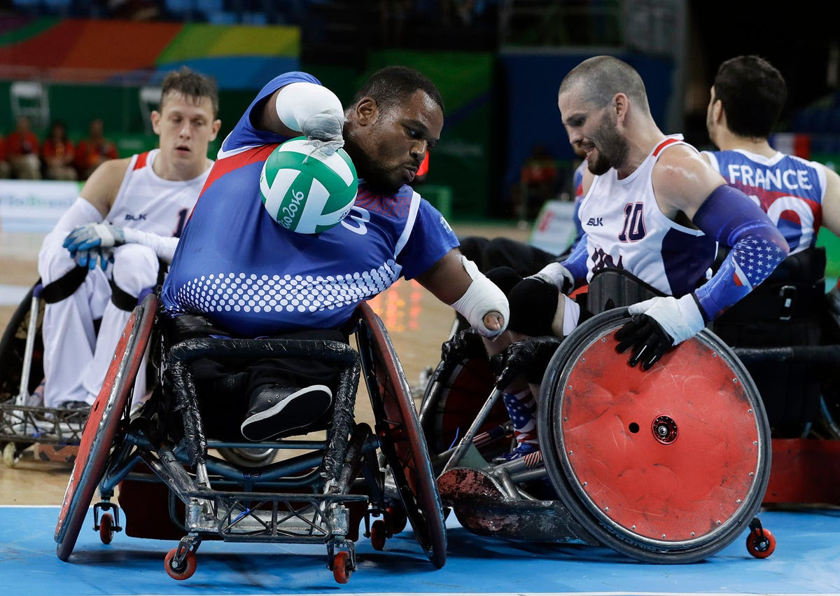 Members of Team France and Team USA compete in mixed wheelchair rugby.