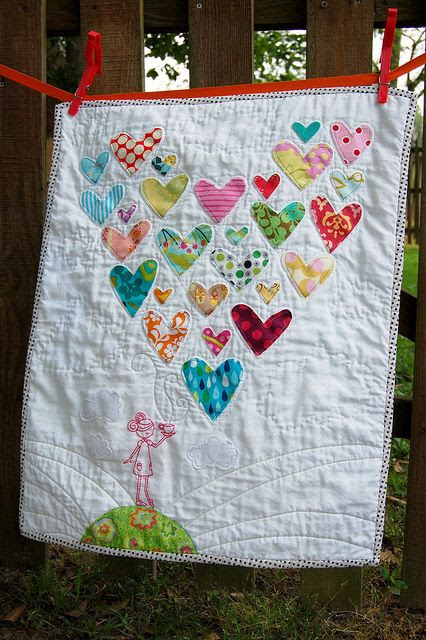 Heart quilt from old baby clothes - so sweet!